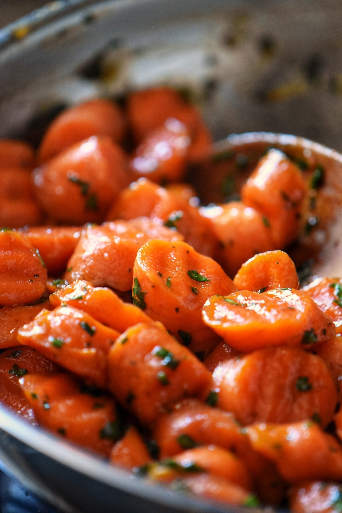 Glazed carrots in a large frying pan.