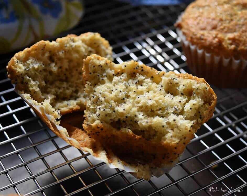 A Buttermilk Oatmeal Muffin is split open to reveal a tender crumb.