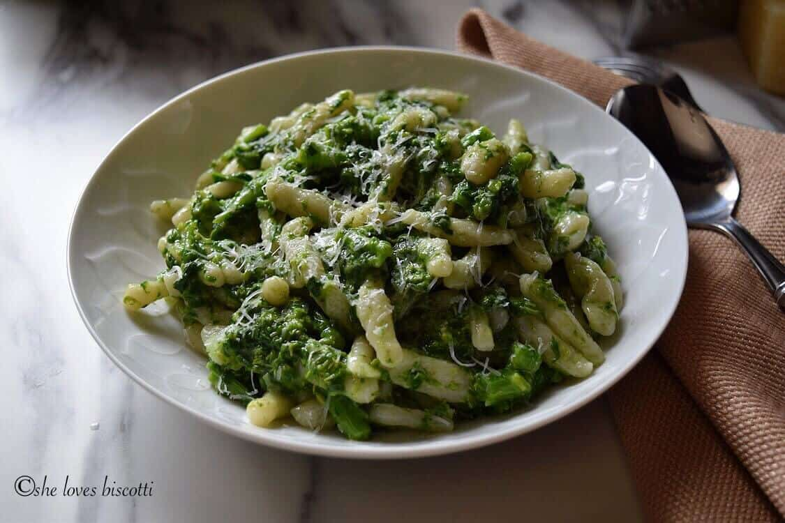 A photo of a white plate filled with the Homemade Italian Broccoli Rabe Cavatelli PastaHomemade Italian Broccoli Rabe Cavatelli Pasta.