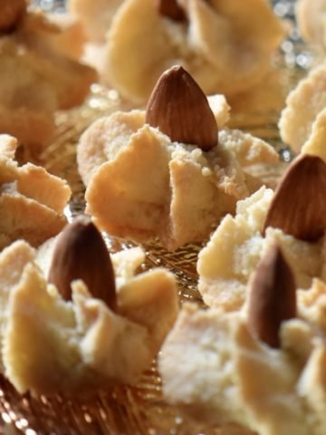 A tray of star shaped Italian almond cookies.