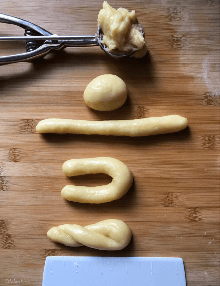 The shaping of a lemon cookie form the scoop of cookie dough, to the rolling ina log, to the formation of a U and finally twisting into shape.