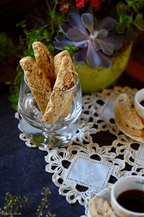 A few Almond Biscotti standing upright in a glass.
