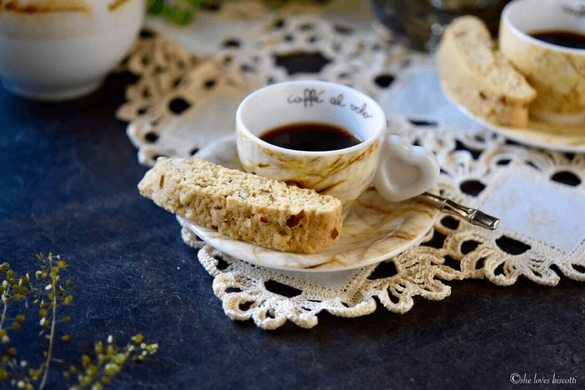 An espresso coffee with an Almond Biscotti.