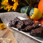 cut up pieces of a dark chocolate nut bark