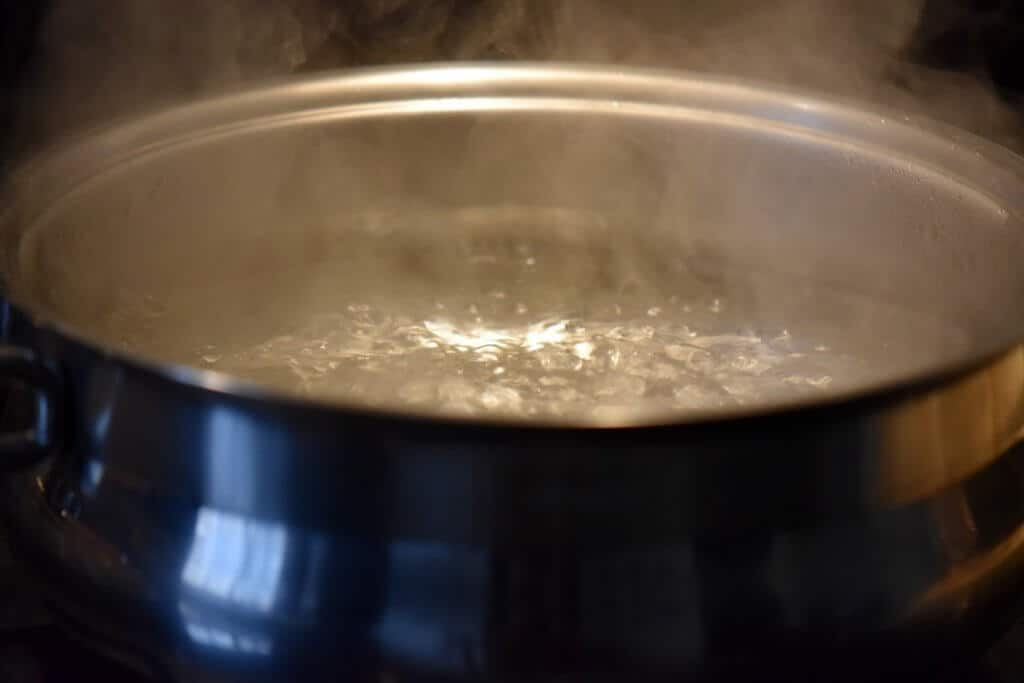 The first step to blanching almonds -a pot of boiling water is brought to a rapid boil.
