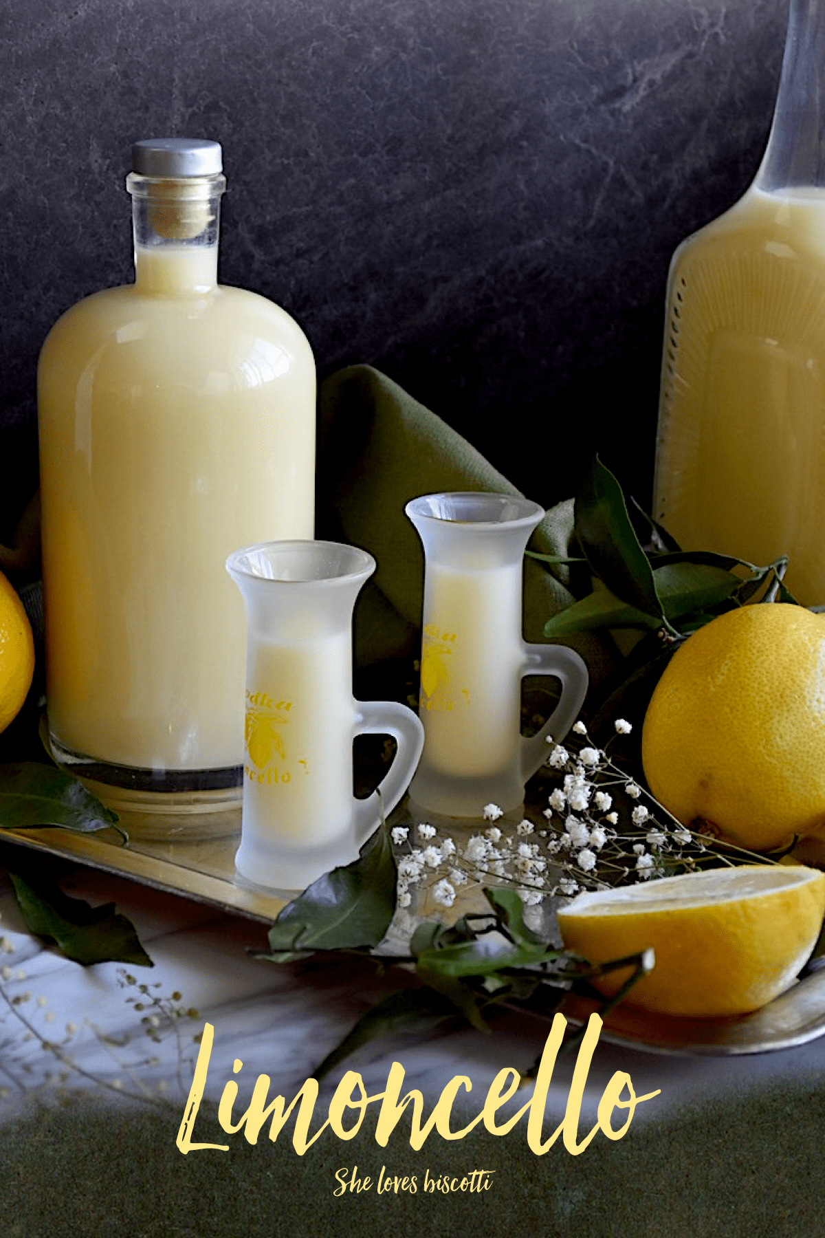 A bottle and a few glasses of limoncello are displayed. for this Crema di Limoncello di Vittoria