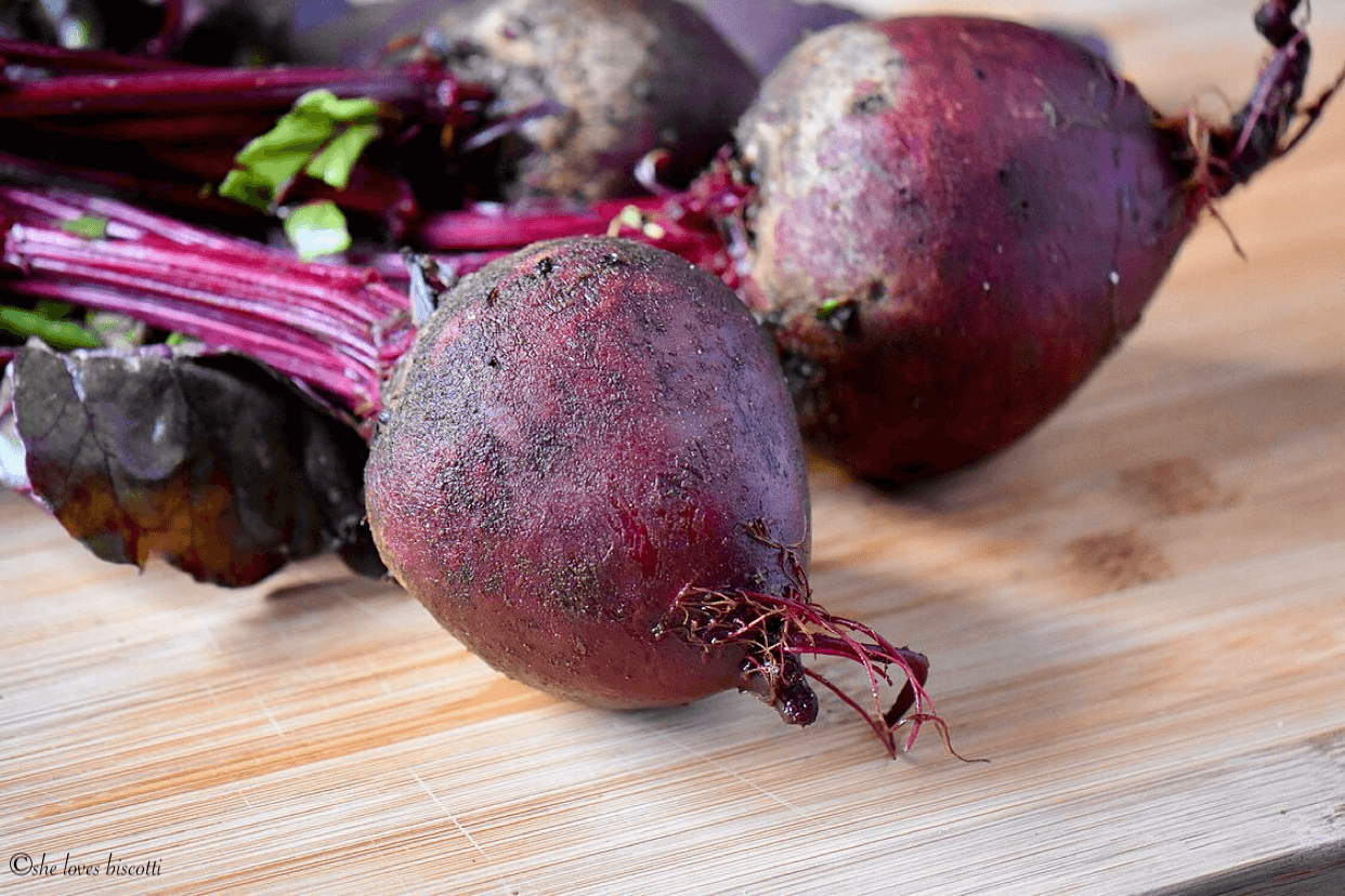 Close up beet root with beet greens.