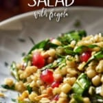 Simple Fregola Spinach Pomegranate Winter Salad in a white bowl.
