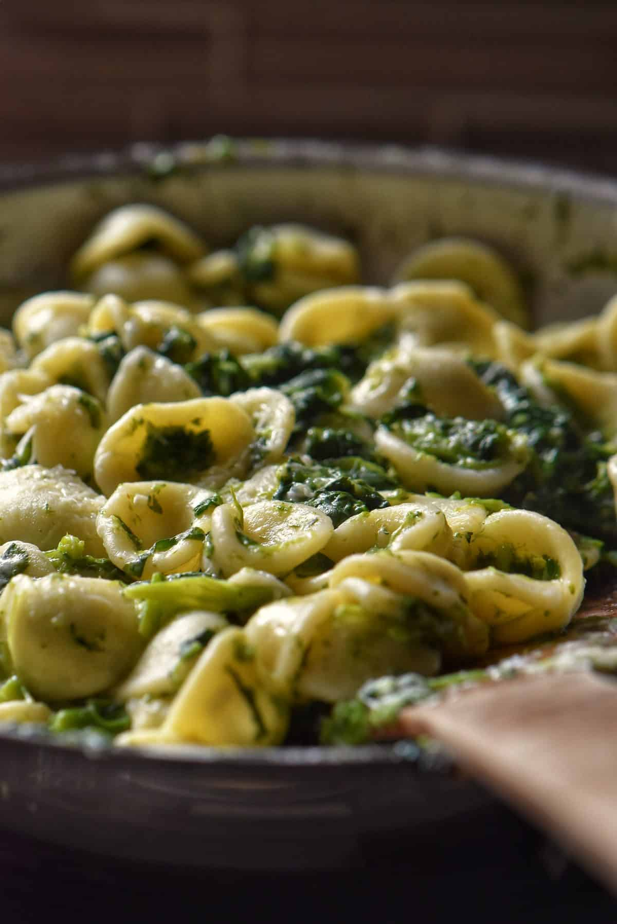 Close up of the pasta with the broccoli rabe in a pan.