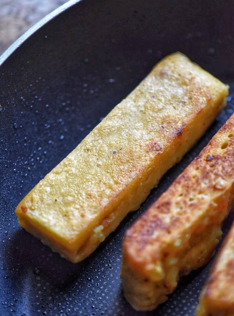 The chickpea sticks being pan fried.