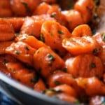 Glazed carrots in a pan.