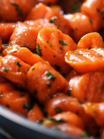 Glazed carrots in a pan.