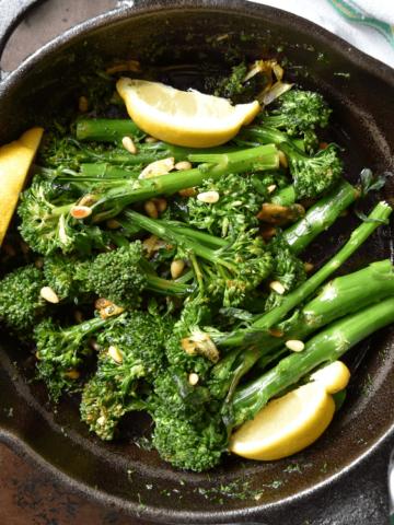 Sauteed Broccolini in a pan.