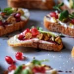 The completed Whipped Ricotta Pomegranate Crostini Recipe.