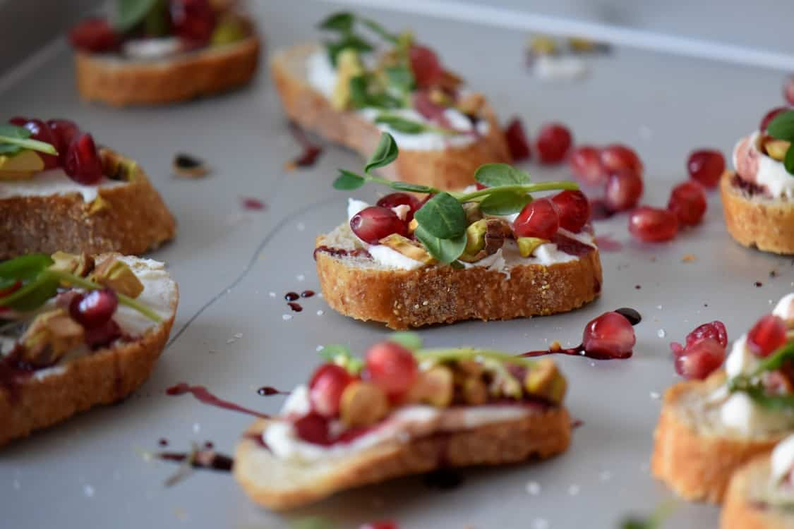 A crostini recipe with whipped ricotta and pomegranates.