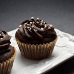 Chocolate Surprise Cupcakes on a white serving tray.