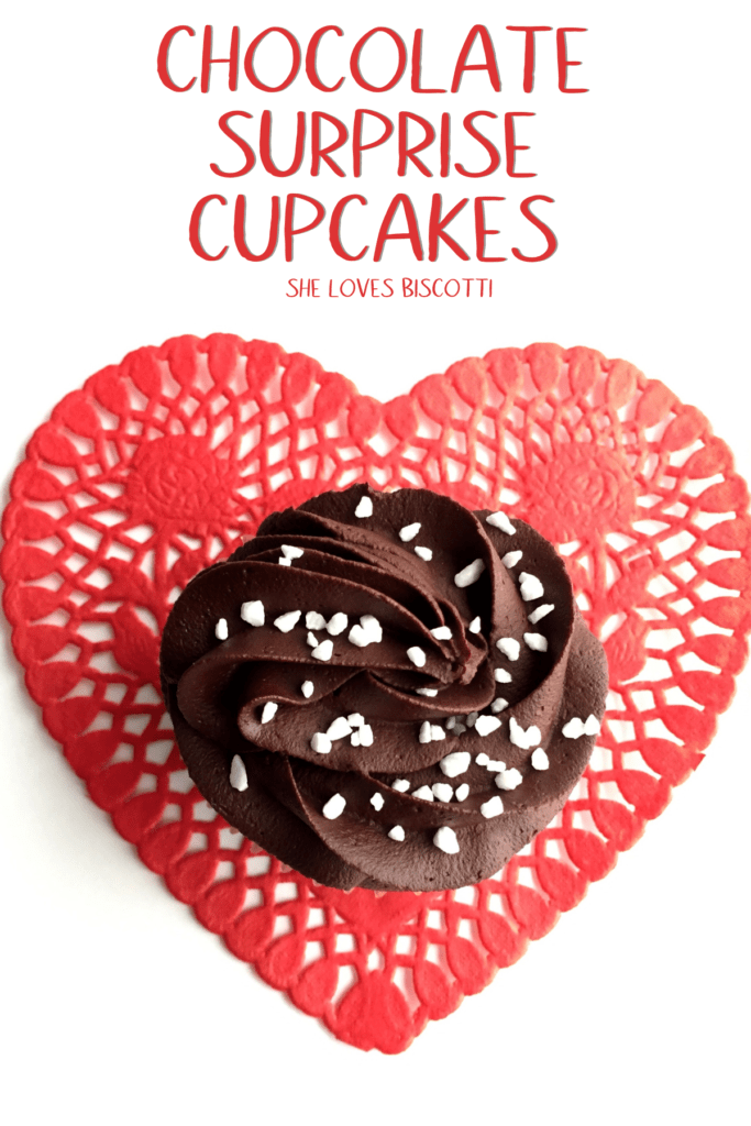 Chocolate Surprise Cupcake placed on a red heart.