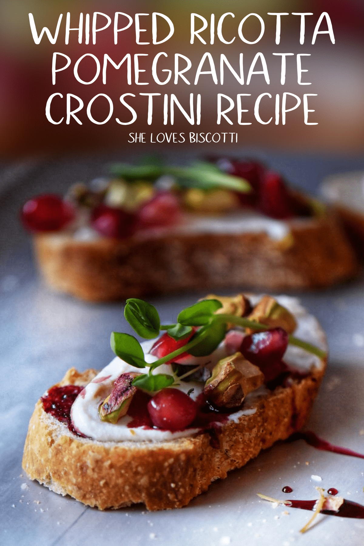 Whipped Ricotta Pomegranate Crostini Recipe: The perfect appetizer!  #shelovesbiscotti #ricottacrostini #appetizer #pomegranate #crostinirecipe #baguettes #holidayappetizers #superbowlappetizer