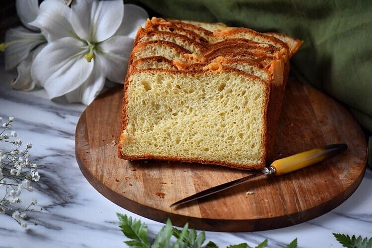 A loaf of the Italian Easter Bread is sliced to reveal the wonderful airy texture of the bread.