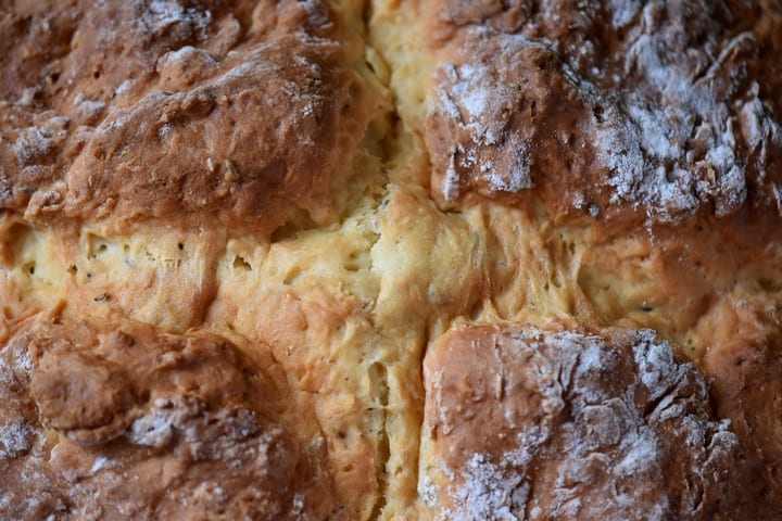 A top view of the soda bread demonstrating the cross in the baked crust top.