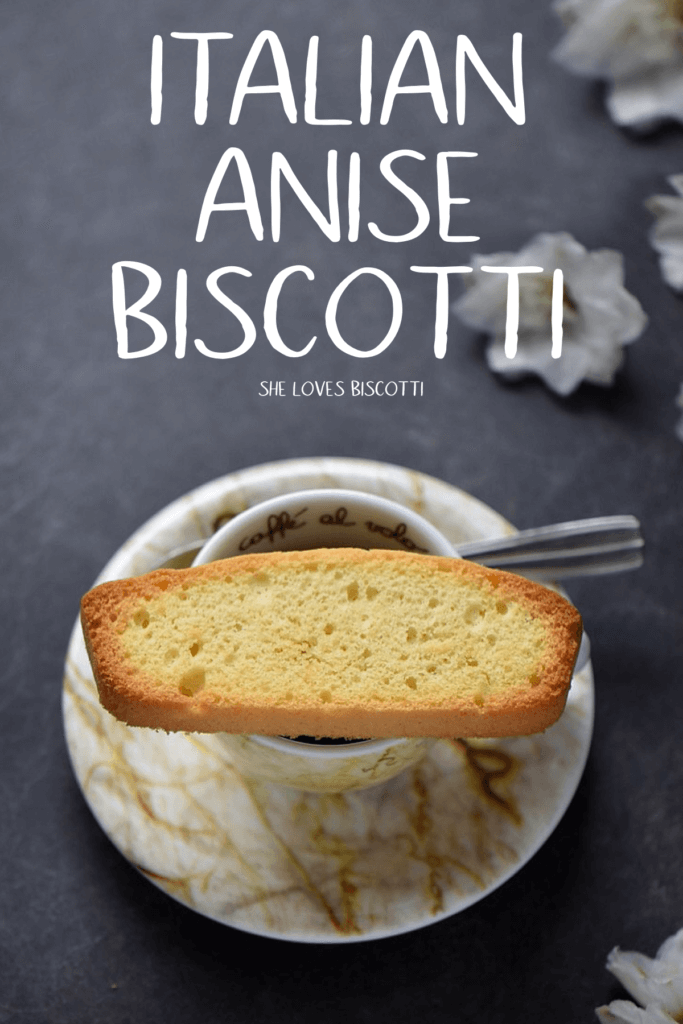A single Italian anise biscotti on an espresso cup.
