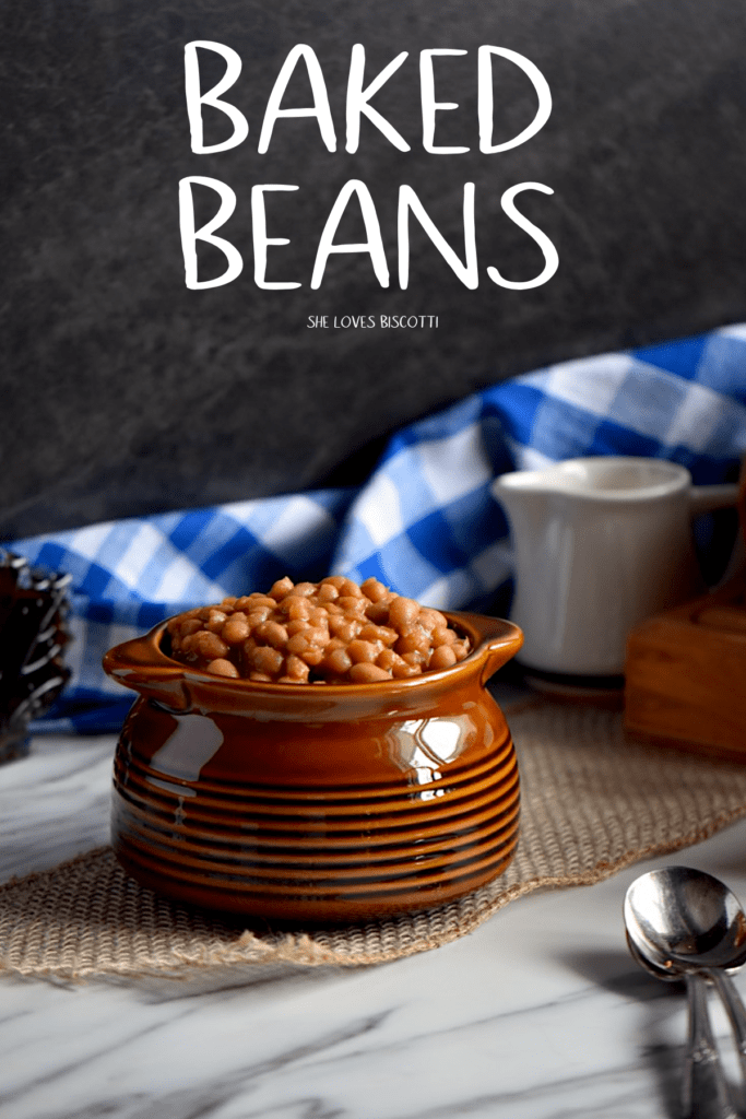 A small ceramic brown bowl filled to the brim with baked beans.