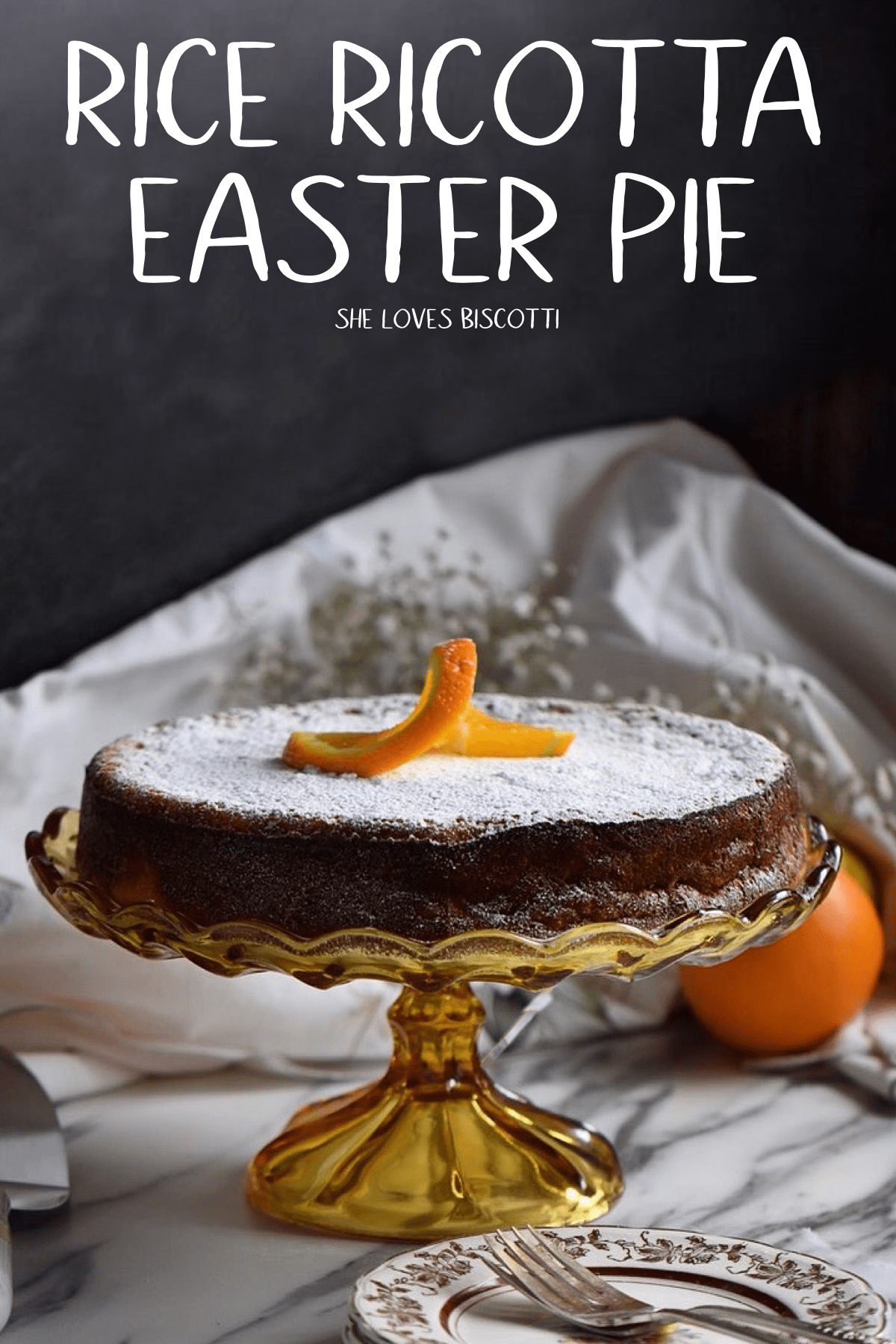 Rice ricotta Easter pie set on a high cake stand.
