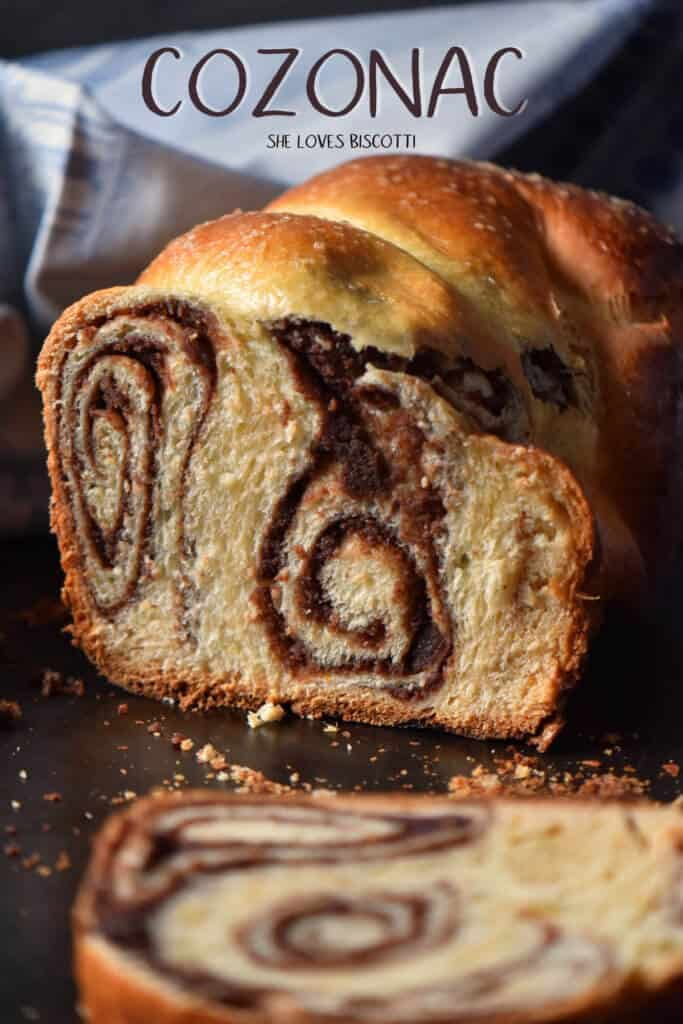 A sliced cozonac loaf with chocolate nutty swirls.