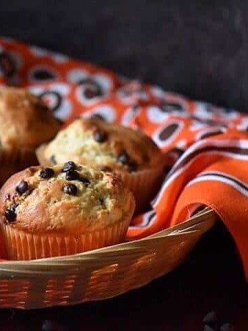 A basket of chocolate chip muffins.