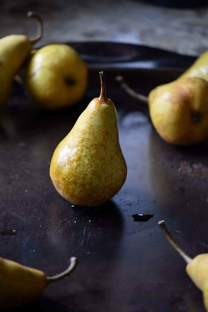 A picture of an upright standing pear.