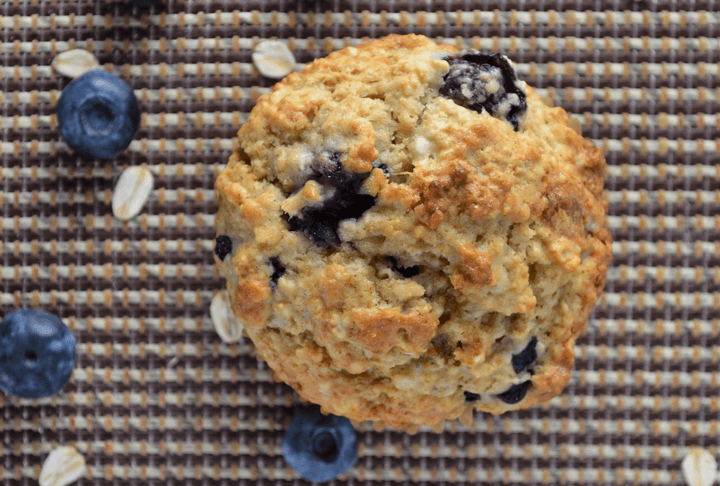 An overhead shot of a perfect blueberry muffin.
