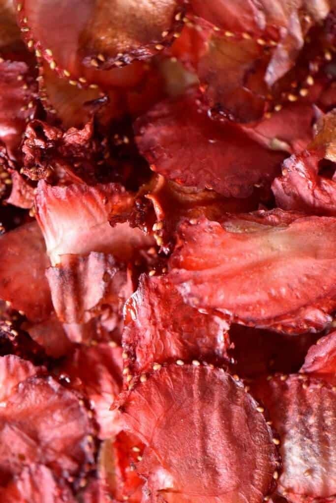 An overhead shot of bright red colored strawberry chips.