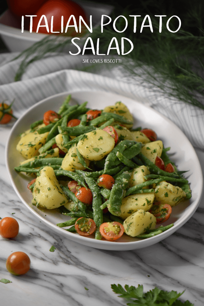 A colorful Italian potato salad made with garden fresh cherry tomatoes, green beans and new potatoes, sliced in half.