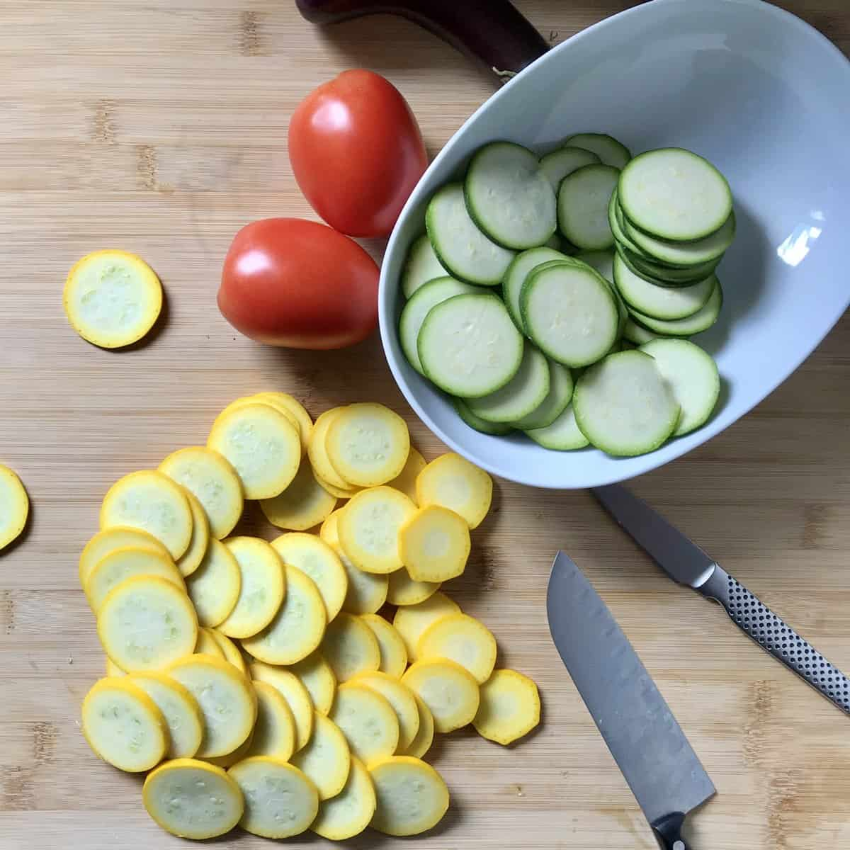 Sliced zucchini on the cutting board.