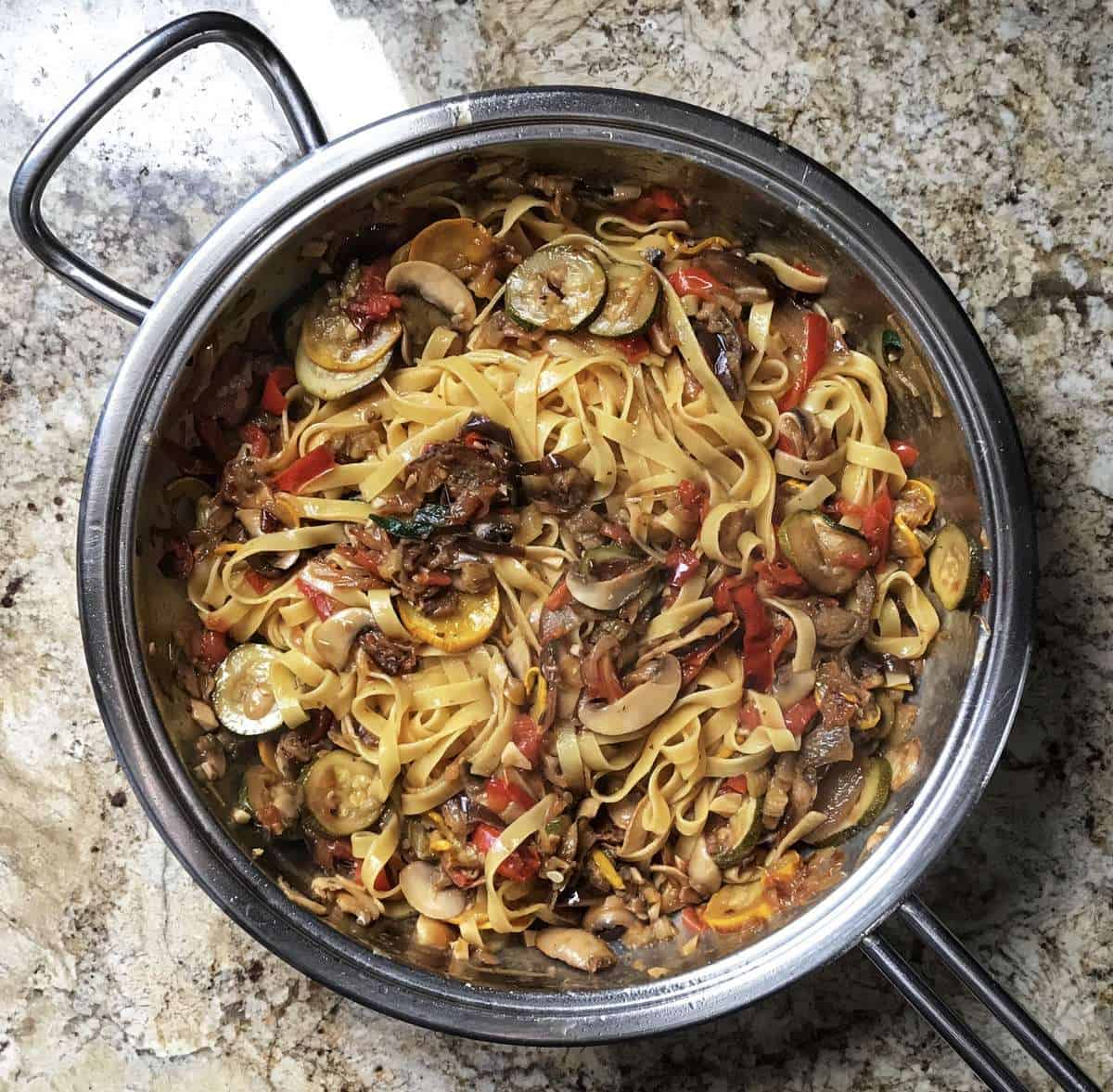 The pasta is now added to the pan of roasted vegetables.