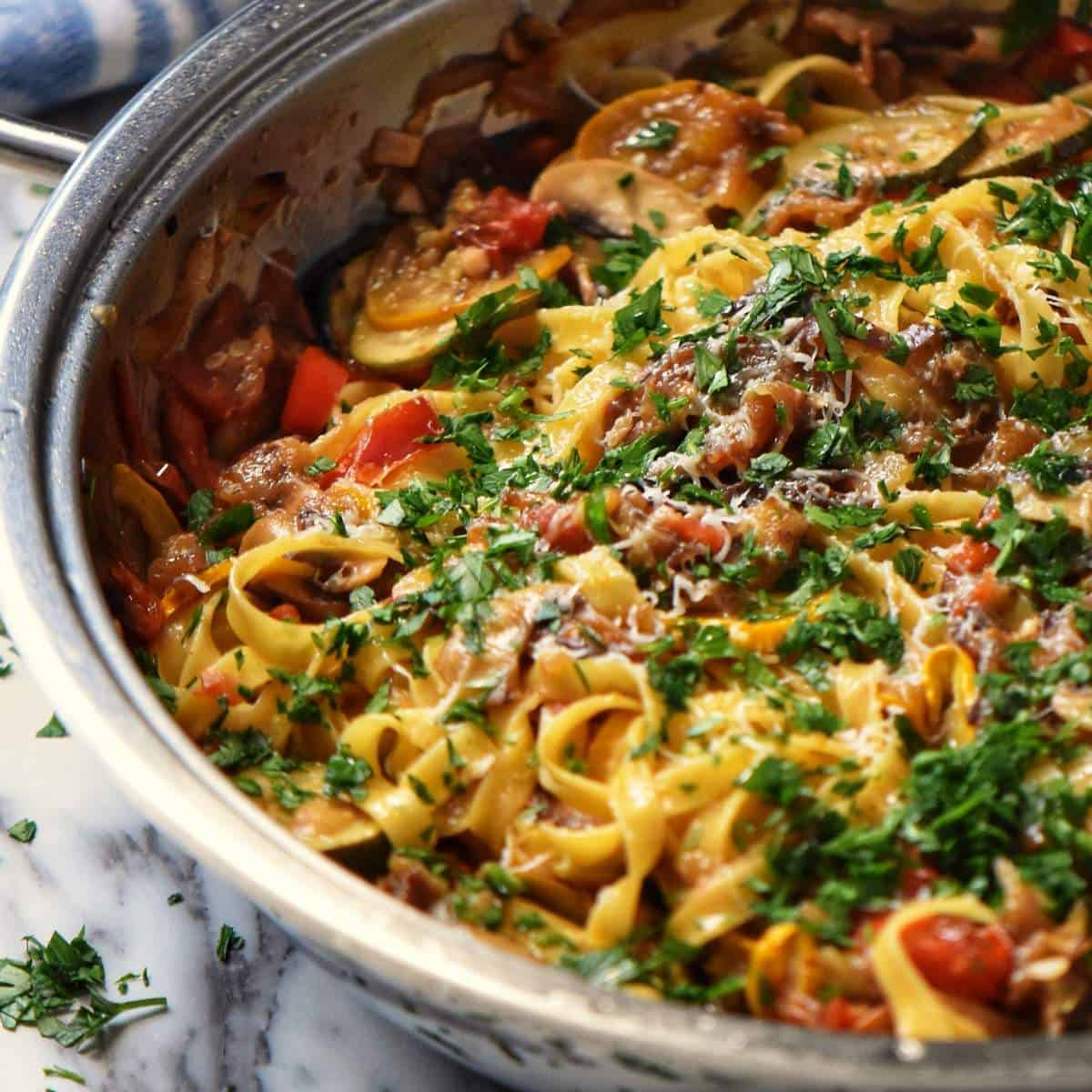 The grilled vegetables have been properly combined with the pasta.