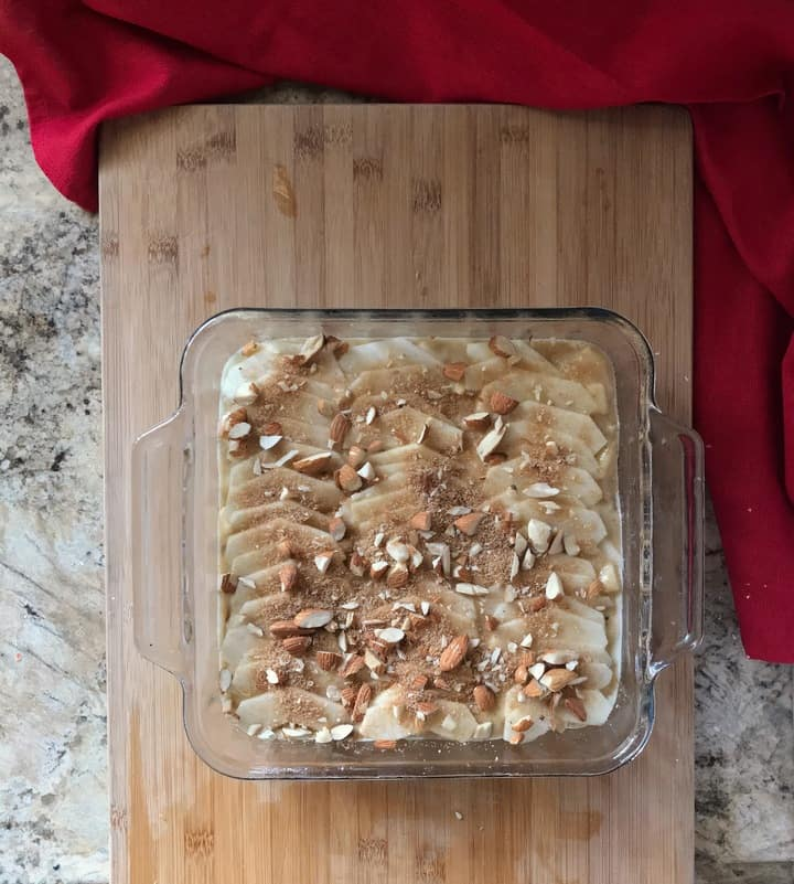 The nut mixture is scattered over the top of the apple squares.