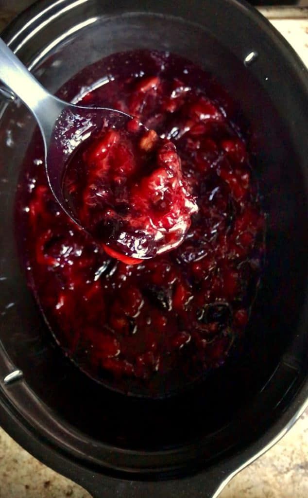 The texture of the plums is shown after an initial cooking period in a slow cooker.