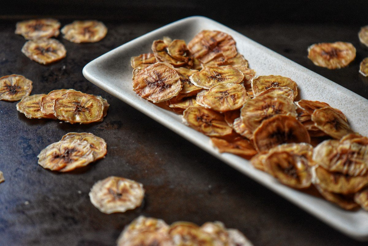 Dried bananas on a white dish.