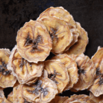 Thinly sliced banana chips piled up high.