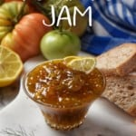 Green tomato jam is part of a simple cheese board surrounded by lemons and green tomatoes.