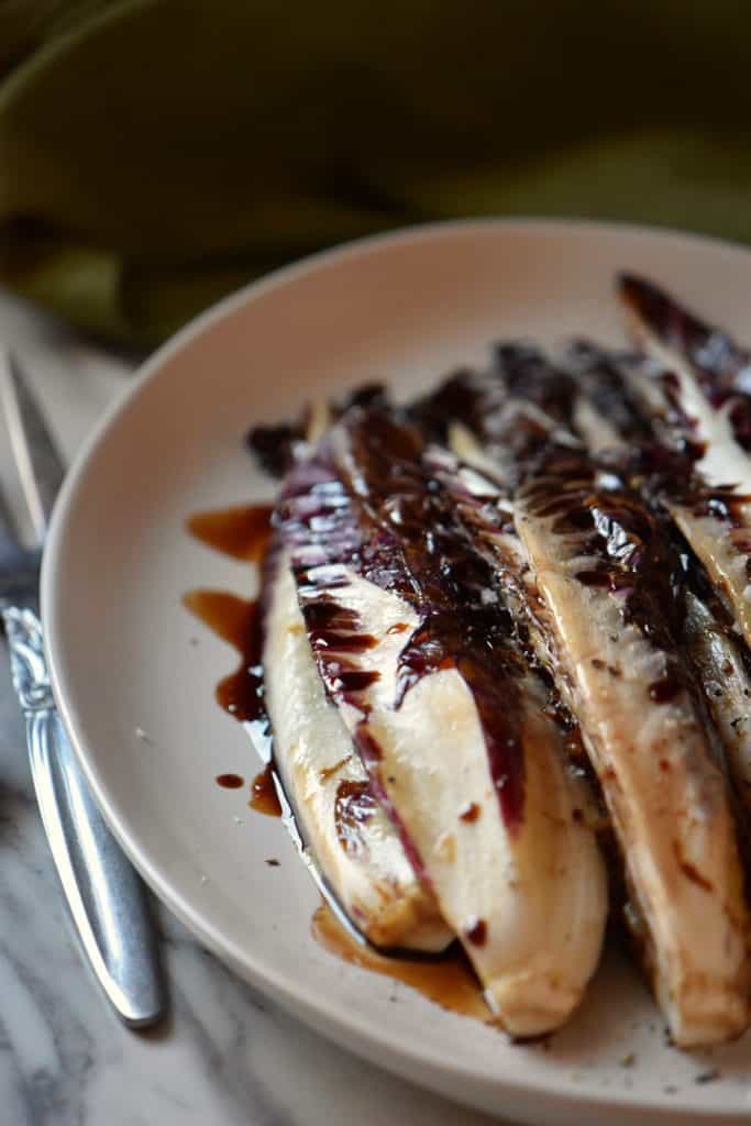 Grilled radicchio sprinkled with salt and pepper and drizzled with balsamic vinegar.