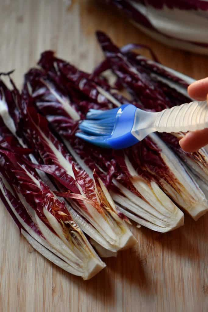 Olive oil is brushed on the radicchio sections before being grilled.