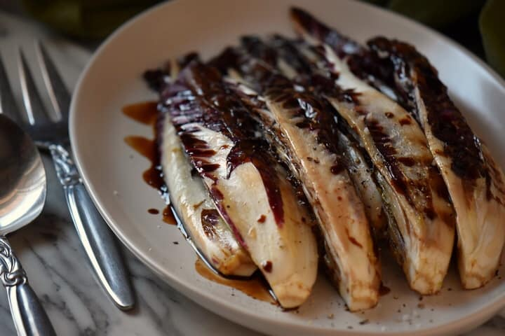 Grilled radicchio ready to be served as a side dish.