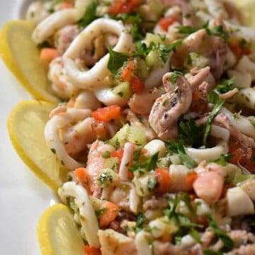 A close up of the seafood salad consisting of calamari, shrimp, octopus and scallops.