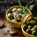 A close up of the perfect party appetizer recipe, Marinated Mozzarella balls.