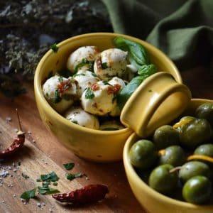 A close up of the perfect party appetizer recipe, Marinated Mozzarella balls.
