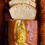 Sliced lemon loaf on a tray.