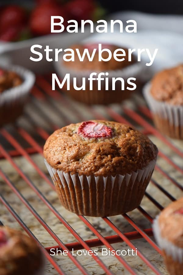 Banana Strawberry muffins on a cooling rack.