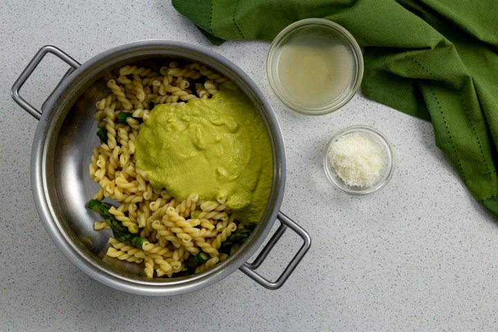 The creamy asparagus sauce about to be combined with the pasta.